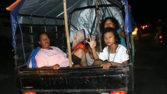 Menschen flüchten vor dem Ausbruch des Vulkans Kelud