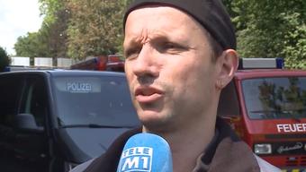 """Ein Arbeiter und andere Zeugen im Beitrag von """"Tele M1""""."""