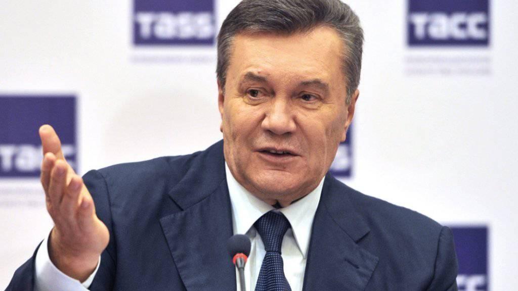 Der frühere Präsident der Ukraine, Viktor Janukowitsch, lebt heute in Russland. Die Proteste auf dem Kiewer Platz Maidan haben zu seiner Absetzung geführt.