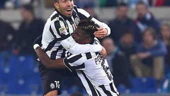 Mit Juventus im Dauerhoch: Carlos Tevez und Paul Pogba