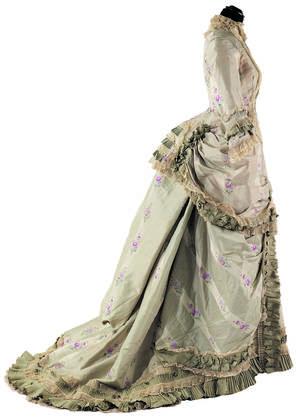 Unter der Robe à la polonaise aus dem späten 19. Jahrhundert steckt ein Faux-cul, ein Polster, das den Po akzentuiert.