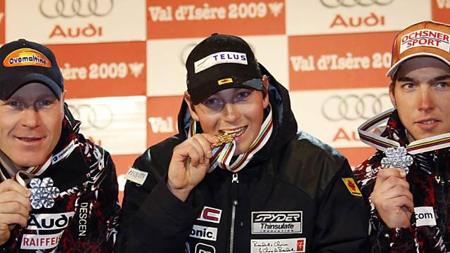 Abfahrts-Weltmeister John Kucera mit Didier Cuche und Carlo Janka.
