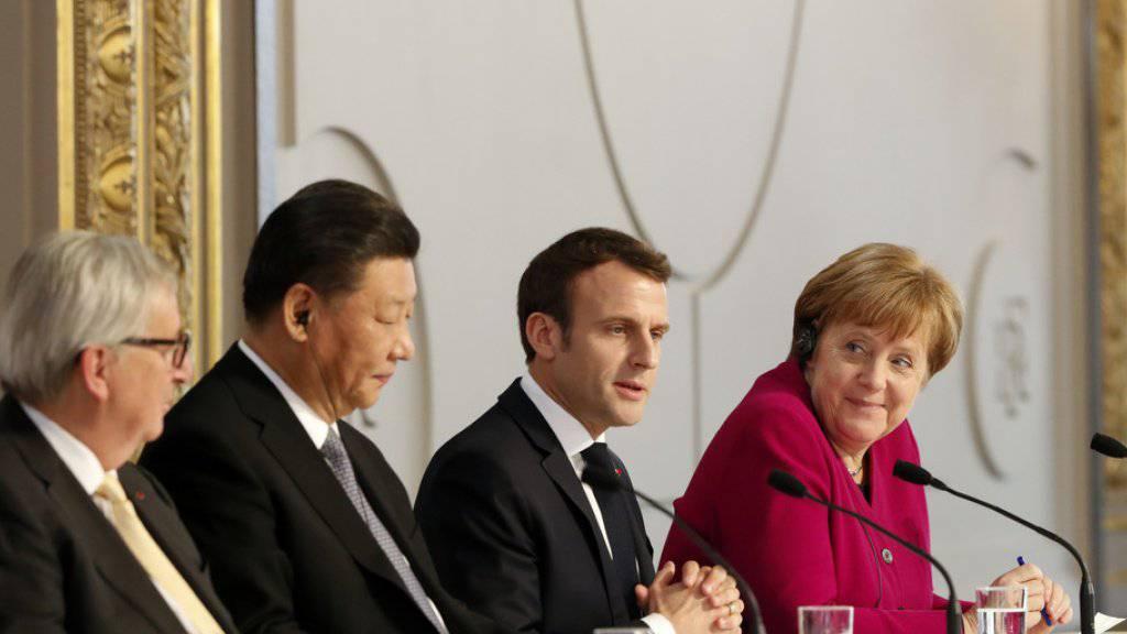 Trafen sich am Dienstag in Paris (v.l.n.r): Jean-Claude Juncker, Xi Jinping, Emmanuel Macron und Angela Merkel.