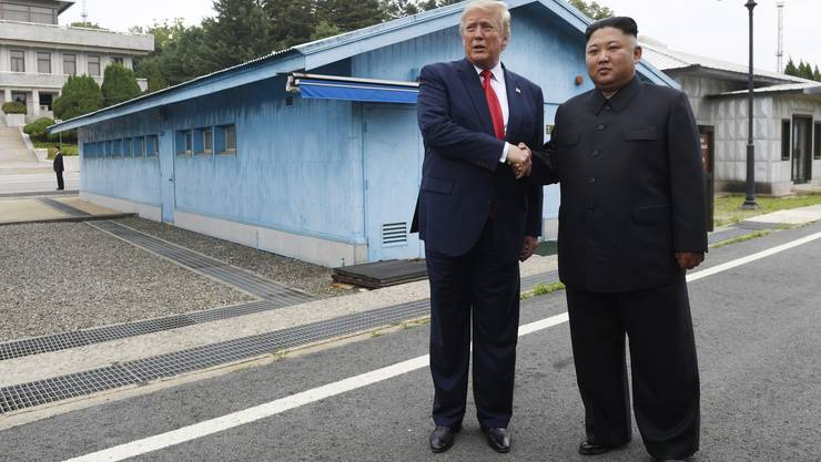 President Donald Trump meets with North Korean leader Kim Jong Un at the border village of Panmunjom in the Demilitarized Zone, South Korea, Sunday, June 30, 2019. (AP Photo/Susan Walsh) Donald Trump,Kim Jong Un