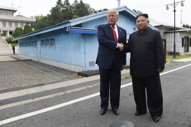 President Donald Trump meets with North Korean leader Kim Jong Un at the border village of Panmunjom in the Demilitarized Zone, South Korea, Sunday, June 30, 2019. (AP Photo/Susan Walsh) Donald Trump,Kim Jong Un