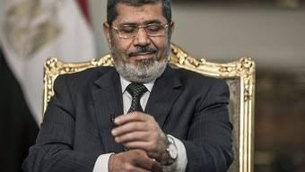 Seinen Sturz durch das ägyptische Militär im Juli 2013 geben militante Islamisten oft als Grund für Terrorakte an: der damalige Präsident Mohammed Mursi (in einer Aufnahme vom Mai 2013).