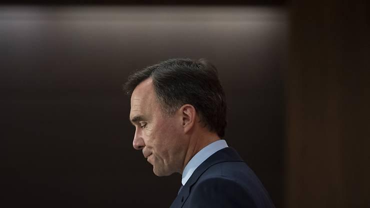 Bill Morneau, Finanzminister von Kanada, gibt seinen Rücktritt während einer Pressekonferenz bekannt. Foto: Justin Tang/The Canadian Press/AP/dpa