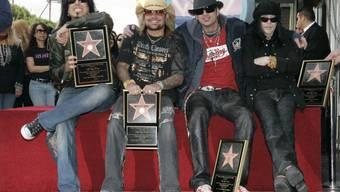 Die wilden Jungs von Mötley Crüe von links: Nikki Sixx, Vince Neil, Tommy Lee und Mick Mars (Archiv).