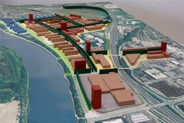 Ungefähr so könnte Salina Raurica in den nächsten Jahren überbaut werden (unten rechts das neue Coop-Produktionszentrum an der Autobahn A2, links der Rhein, oben die Gebiete Pratteln-Längi und Augst). Ken