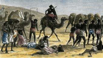 Sklavenkarawane in Afrika, 1884 – das Verbrechen an schwarzen Menschen («Negern») wurde von weissen Europäern rassistisch rationalisiert.akg-images