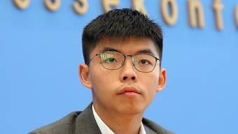 ARCHIV - Joshua Wong, Studentenaktivist in Hongkong und Generalsekretär der regierungskritischen Partei Demosisto, in der Bundespressekonferenz in Berlin. Foto: Wolfgang Kumm/dpa