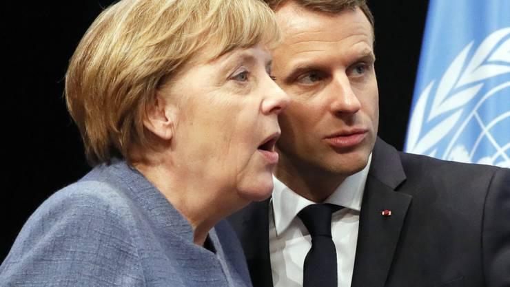 Bundeskanzlerin Angela Merkel und Frankreichs Präsident Emanuel Macron in Bonn während der Eröffnung des Ministerteils der Klimakonferenz.