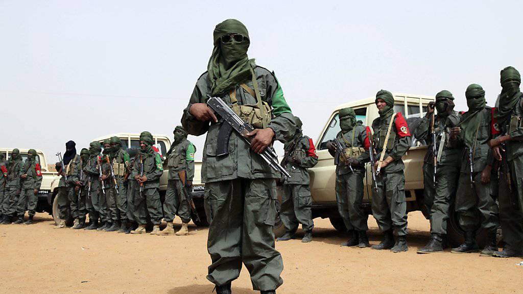 Im Bild ist eine gemeinsame Patrouille der malischen Soldaten und von Tuareg-Rebellen in Gao zu sehen. (Archiv)