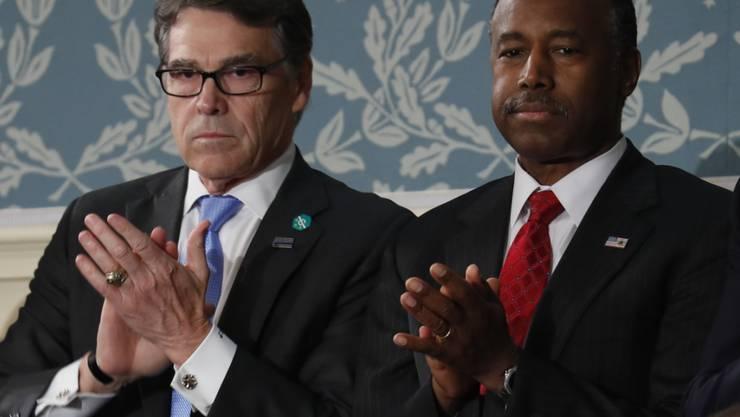 Die zwei neuen Minister, Rick Perry (l) und Ben Carson (Archiv)