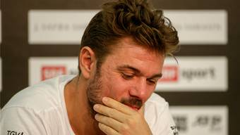 Ein nachdenklicher Stan Wawrinka gibt vor seinem Erstrundenspiel an der Pressekonferenz Auskunft.
