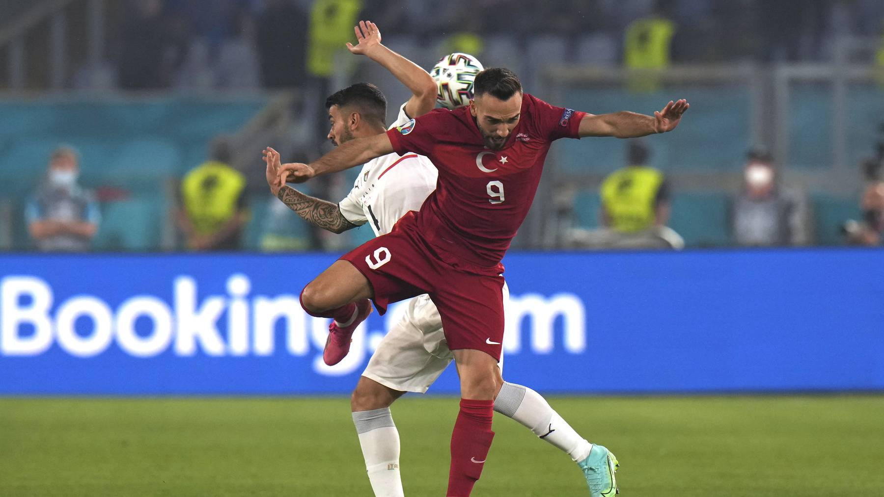 Kenan Karaman of Turkey and Leonardo Spinazzola (L) of Italy in action during the UEFA EURO 2020 group A preliminary round soccer match between Turkey and Italy at the Olympic Stadium in Rome, Italy, 11 June 2021.