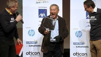 Samih Sawiris (M) nimmt die Auszeichnung mit Humor