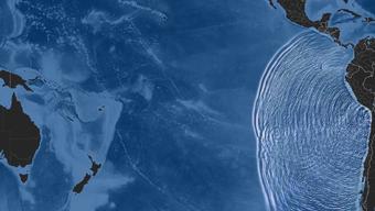 Eine Computeranimation zeigt, wie sich der Tsunami ausbreitet.