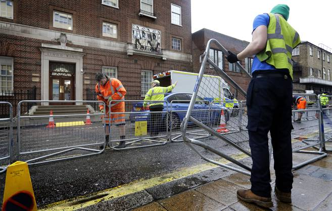 Barriers are erected outside the Lindo Wing of St. Mary's Hospital in Paddington, London, Monday, April 9, 2018. Britain's Prince William and Kate, Duchess of Cambridge, are expecting their third child to be born at the hospital, sometime in the coming weeks. (AP Photo/Kirsty Wigglesworth)