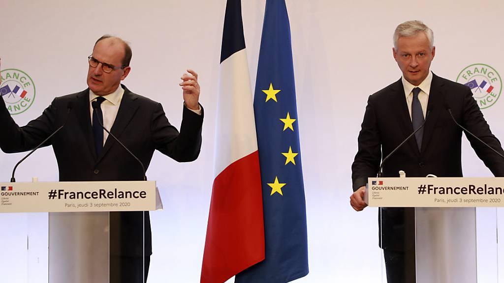 Jean Castex (l), Premierminister von Frankreich, spricht bei einer gemeinsamen Pressekonferenz mit Bruno Le Maire, Wirtschaftsminister von Frankreich. Foto: Ludovic Marin/POOL AFP/AP/dpa