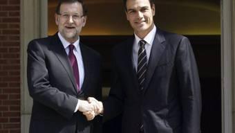 Regierungschef Rajoy (l) und PSOE-Chef Sanchez (Archiv)