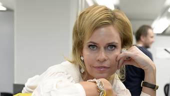 Jetset-Lady Irina Beller - hier als Aushängeschild der neuen Sihlpost in Zürich - engagiert sich für eine Burnout-Hotline. Denn auch sie hatte einmal ein schweres Leben. (Archivbild)