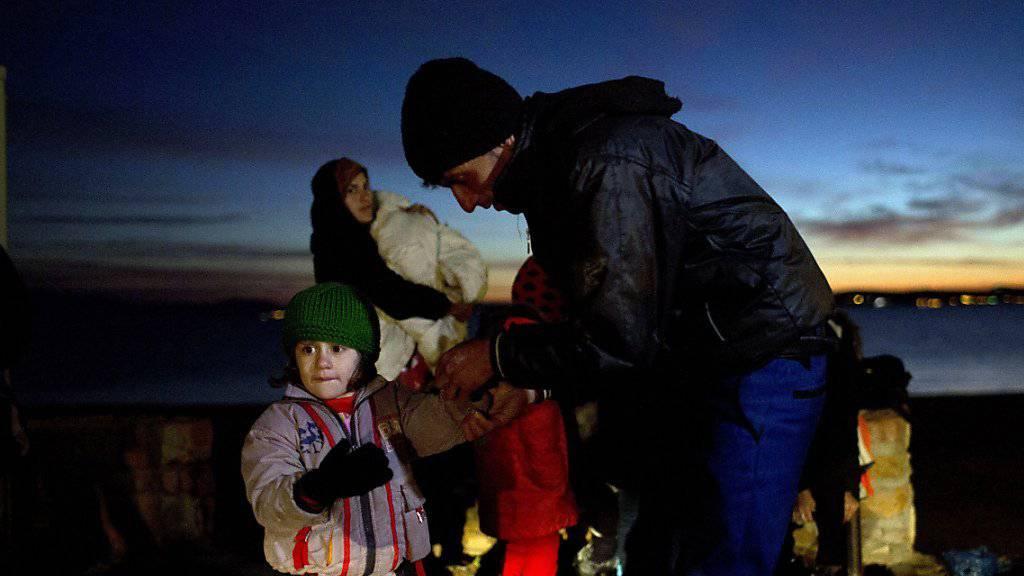 Afghanische Flüchtlingsfamilie nach ihrer Ankunft auf der griechischen Insel Chios