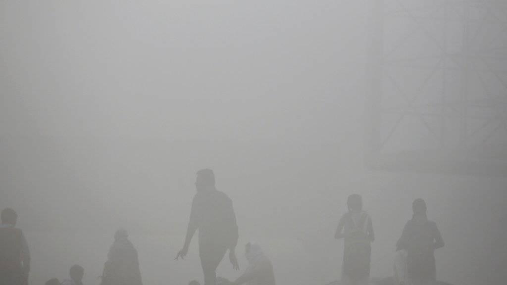 Trotz der dicken Smog-Decke fand in Neu Delhi ein Marathon statt. (Archiv)