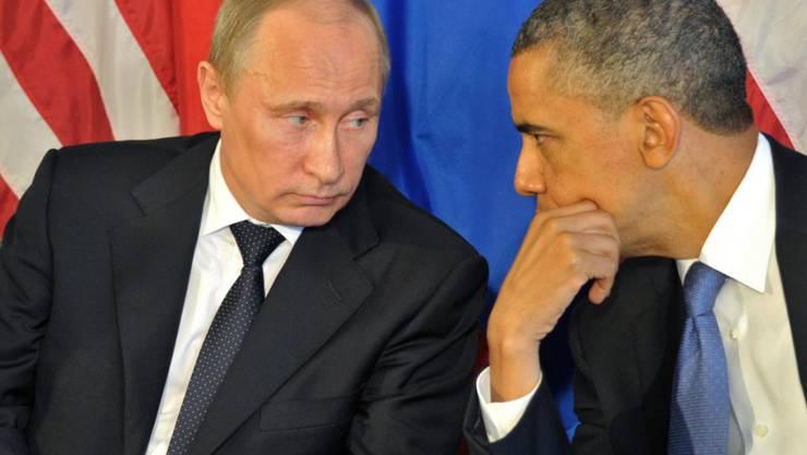 Wladimir Putin (links) und Barack Obama bei einem Treffen 2012 in Mexiko. Am Mittwoch telefonierten die beiden und diskutierten über die Lage in Syrien. (Archivbild)