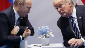Russlands Präsident Vladimir Putin und US-Präsident Donald Trump am G-20-Gipfel im Juli 2017 in Hamburg. (Archivbild)