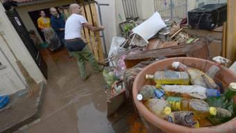 Aufräumen nach dem grossen Unwetter in Olbia