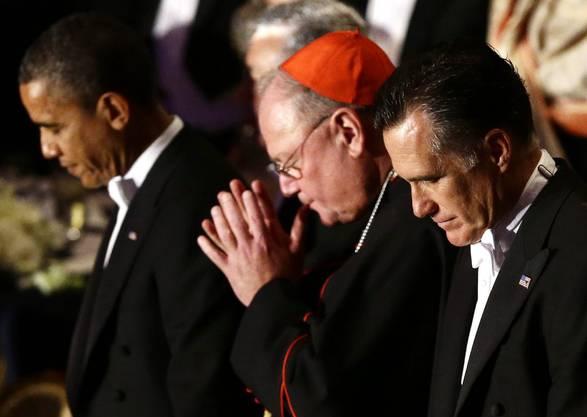 Die beiden Kandidaten im Gebet mit dem Erzbischof von New York