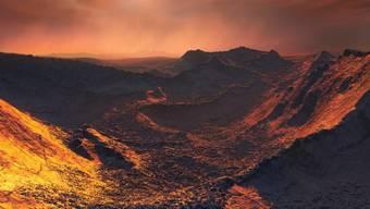 """So könnte es auf der neu entdeckten Supererde aussehen: Das Zentralgestirn """"Barnard's Star"""" spendet nur schummriges Licht."""