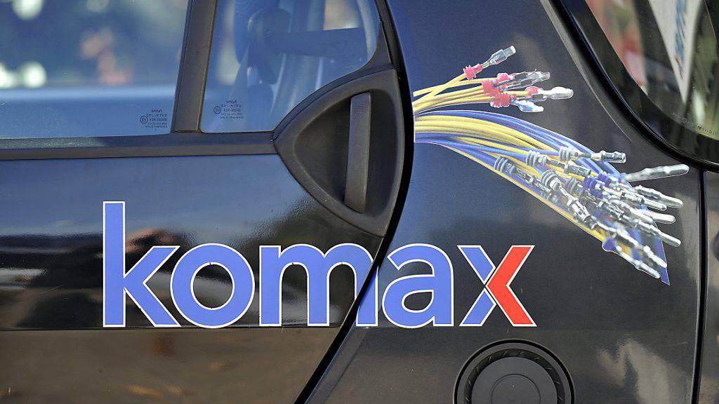 Komax rutscht trotz Kostensenkungen in die roten Zahlen