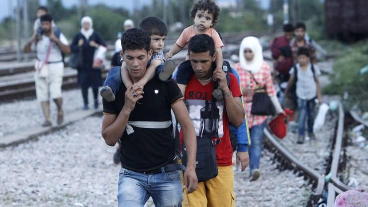 Flüchtlinge auf dem Weg nach Europa. (Symbolbild)