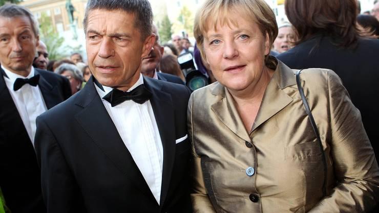 Das Ehepaar Joachim Sauer und Angela Merkel