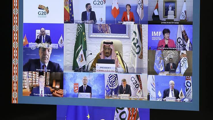 Charles Michel, Präsident des Europäischen Rats (unten), nimmt am virtuellen G20-Gipfel unter Vorsitz Saudi-Arabiens teil. Foto: Yves Herman/Pool Reuters/AP/dpa
