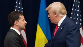 Kommen beide ans WEF: Die Präsidenten Selenskyj (.) und Trump. Seit dem Start des Impeachments haben sie sich nicht mehr getroffen.