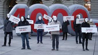 Befürworter eines flächendeckenden Mindestlohns von 4000 Franken an einer Demonstration.
