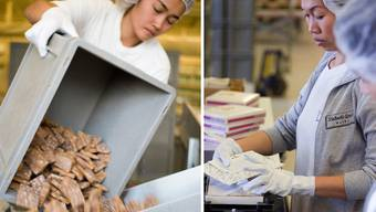 Schlecht bezahlte Mitarbeiterinnen der Läckerli-Huus AG verpacken die Basler Spezialität in Kartonschachteln. (Archiv)