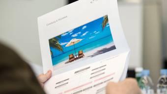 Das Schweizer Reiseunternehmen Hotelplan kündigte am Donnerstag einen grösseren Stellenabbau an. (Symbolbild)