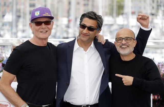 Filmpremiere in Cannes (von links nach rechts): Maradonas ehemaliger Fitnesstrainer Fernando Signori, Filmregisseur Asif Kapadia und Maradonas Biograf Daniel Arcucci.