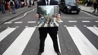 «Abbey Road» ist das Beatles-Album mit dem wohl berühmtesten Titelfoto der Band, der Zebrastreifen selbst längst ein Magnet für London-Besucher.