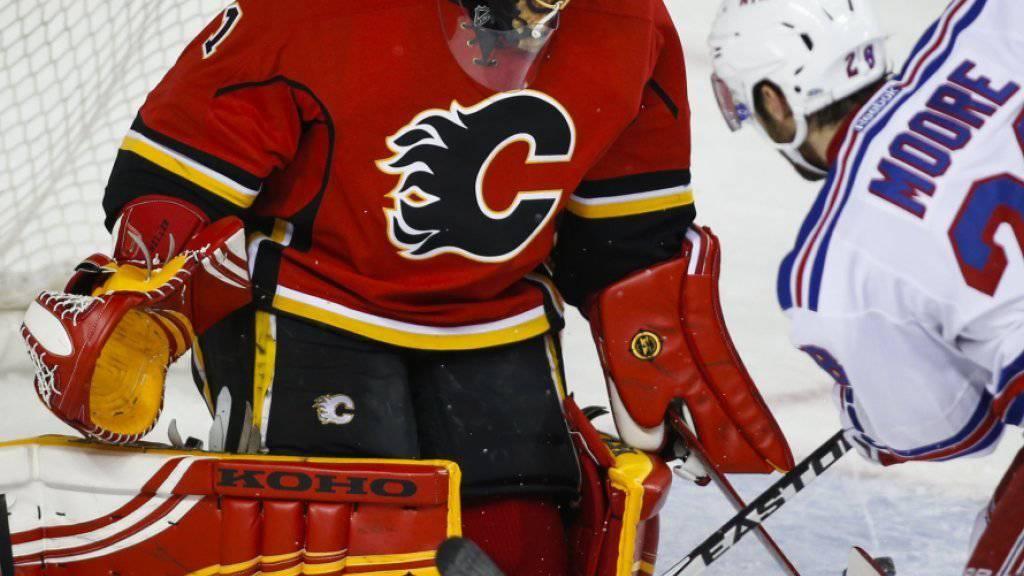 Die Calgary Flames und Goalie Jonas Hiller (links) sind derzeit nicht zu stoppen