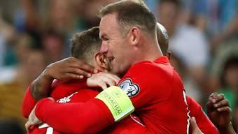 Können jubeln: Wayne Rooney (rechts) und seine Mitspieler.