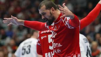 Kroatiens Zeljko Musa lässt sich gegen Co-Gastgeber Österreich als Torschütze feiern