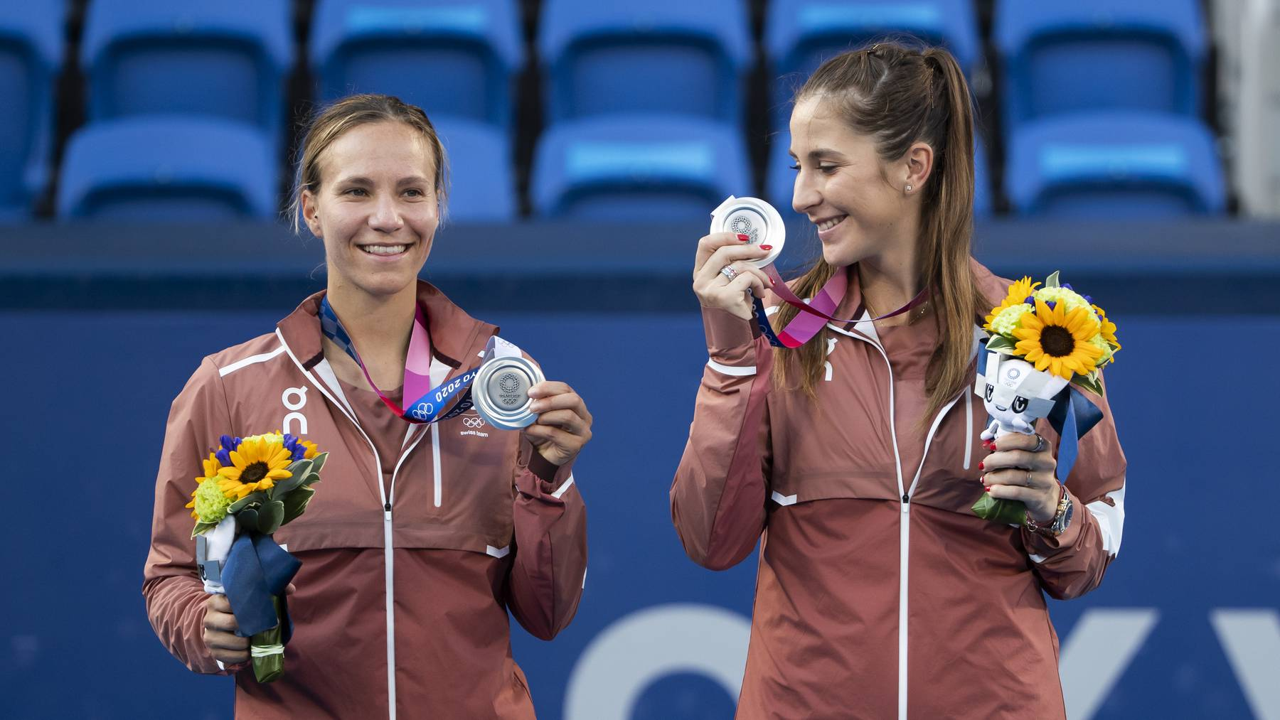 Belinda Bencic, right, and Viktorija Golubic of Switzerland pose with their silver medals on the podium afteer the women's tennis doubles gold medal match against Barbora Krejcikova and Katerina Siniakova of The Czech Republic at the 2020 Tokyo Summer Olympics in Tokyo, Japan, on Sunday, August 01, 2021.