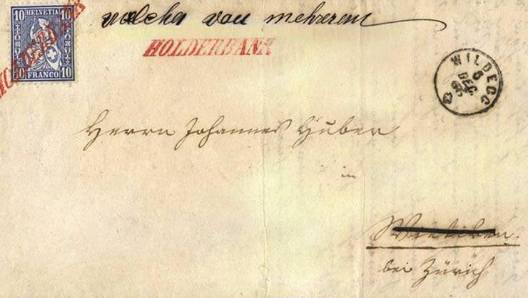 Der Faltbrief von 1865 wurde in altdeutscher Schrift verfasst. Der Ort wurde durchgestrichen, offenbar war die Adresse des Empfängers unklar. Das Aussergewöhnliche: Die Marke wurde rot abgestempelt.