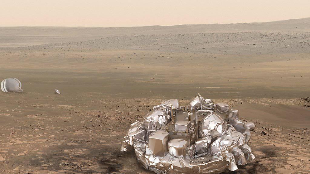 So hätte die Sonde «Schiaparelli» nach erfolgreicher Landung aussehen sollen - stattdessen donnerte sie mit mehr als 500 Stundenkilometern auf die Marsoberfläche. Wieso dies geschah, haben Wissenschaftler nun herausgefunden.
