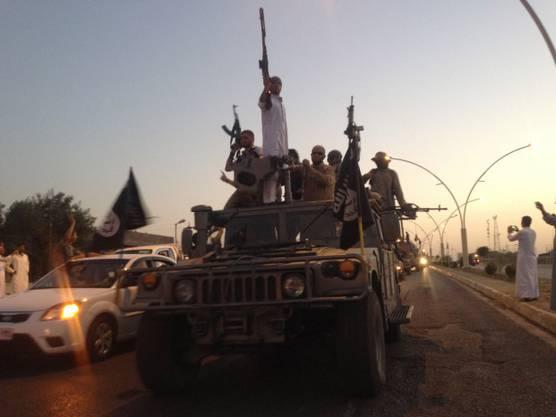 «IS»-Kämpfer auf dem Triumphzug durch Mosul im Juni 2014.
